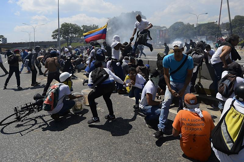 Opposition demonstrators clashes with soldiers loyal to Venezuelan President Nicolas Maduro after troops joined opposition leader Juan Guaido in his campaign to oust Maduro's government, in the surroundings of La Carlota military base in Caracas on April 30, 2019. (Photo: Matias Delacroix/AFP/Getty Images)