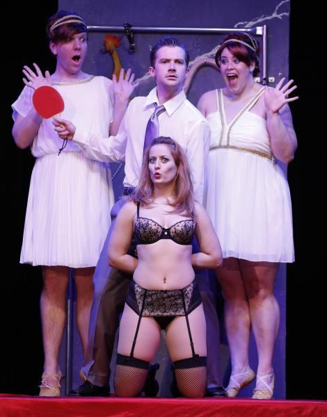 """This theater publicity image released by David Gersten & Associates shows clockwise from top left, Alex Gonzalez, Matthew Brian Bagley, Tina Jensen and Laurie Elizabeth Gardner during a performance of """"Cuff Me: The Fifty Shades of Grey (Unauthorized) Musical Parody,"""" in New York. (AP Photo/David Gersten & Associates, Carol Rosegg)"""