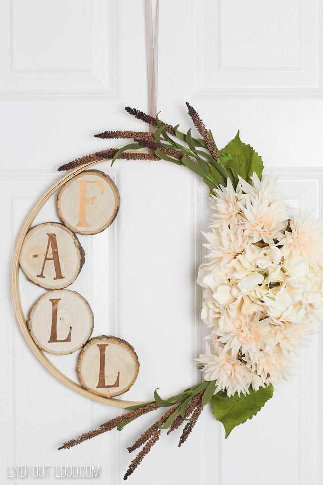 """<p>Your neighbors will refuse to believe you made this sophisticated wreath yourself. With just a few letter stickers, some rustic wood slabs, and an inexpensive embroidery hoop, you'll be well on your way to impressing them.</p><p><strong>Get the tutorial at <a href=""""https://lydioutloud.com/how-to-make-embroidery-hoop-wreath-wood-slices/"""" rel=""""nofollow noopener"""" target=""""_blank"""" data-ylk=""""slk:Lydi Out Loud"""" class=""""link rapid-noclick-resp"""">Lydi Out Loud</a>.</strong><strong><br></strong></p><p><strong><a class=""""link rapid-noclick-resp"""" href=""""https://go.redirectingat.com?id=74968X1596630&url=https%3A%2F%2Fwww.walmart.com%2Fsearch%2F%3Fquery%3Dembroidery%2Bhoops&sref=https%3A%2F%2Fwww.thepioneerwoman.com%2Fhome-lifestyle%2Fdecorating-ideas%2Fg36732301%2Foutdoor-fall-decorations%2F"""" rel=""""nofollow noopener"""" target=""""_blank"""" data-ylk=""""slk:SHOP EMBROIDERY HOOPS"""">SHOP EMBROIDERY HOOPS</a></strong></p>"""