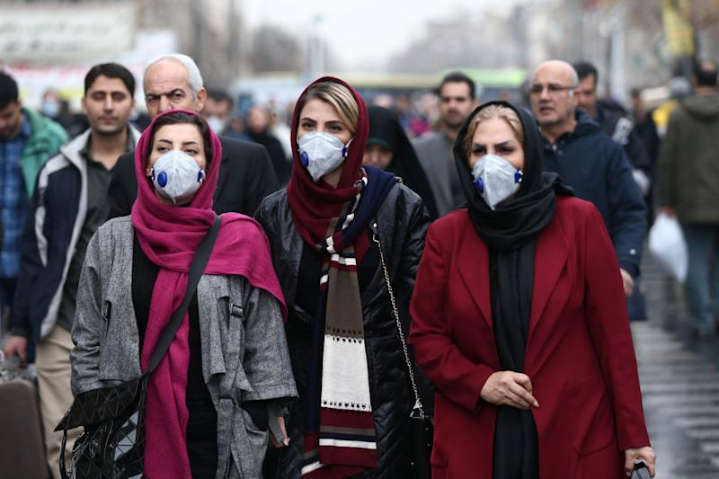 Women wearing protective masks in Tehran amid Iran's Covid-19 outbreak.