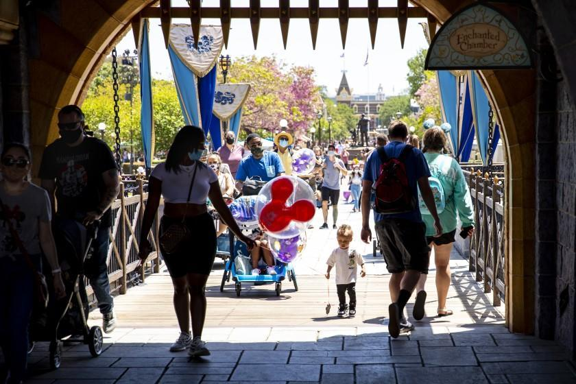 ANAHEIM, CA - May 03: Visitors pass through Sleepy Beauty Castle at Disneyland Resort in Anaheim, CA, as visitors return to the park with covid-safety restrictions in place, including the park only being at 25% capacity, Monday, May 3, 2021. (Jay L. Clendenin / Los Angeles Times)