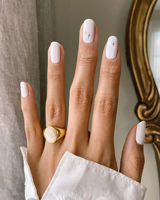 """<p>Colour co-ordinate your white wedding dress with your white nail art and add a few Disney-worthy stars for a dreamy bridal manicure.</p><p><a href=""""https://www.instagram.com/p/CAGwCijAQej/?utm_source=ig_embed&utm_campaign=loading"""" rel=""""nofollow noopener"""" target=""""_blank"""" data-ylk=""""slk:See the original post on Instagram"""" class=""""link rapid-noclick-resp"""">See the original post on Instagram</a></p>"""