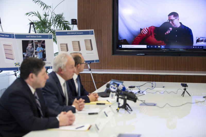 Joleen and Craig Dudek, top right, comfort each other as they join a news conference in Philadelphia via video, Monday, Jan. 6, 2020. IKEA has agreed to pay $46 million to the parents of their 2-year-old boy who died of injuries suffered when a 70-pound recalled dresser tipped over onto him, the family's lawyers said Monday. (AP Photo/Matt Rourke)