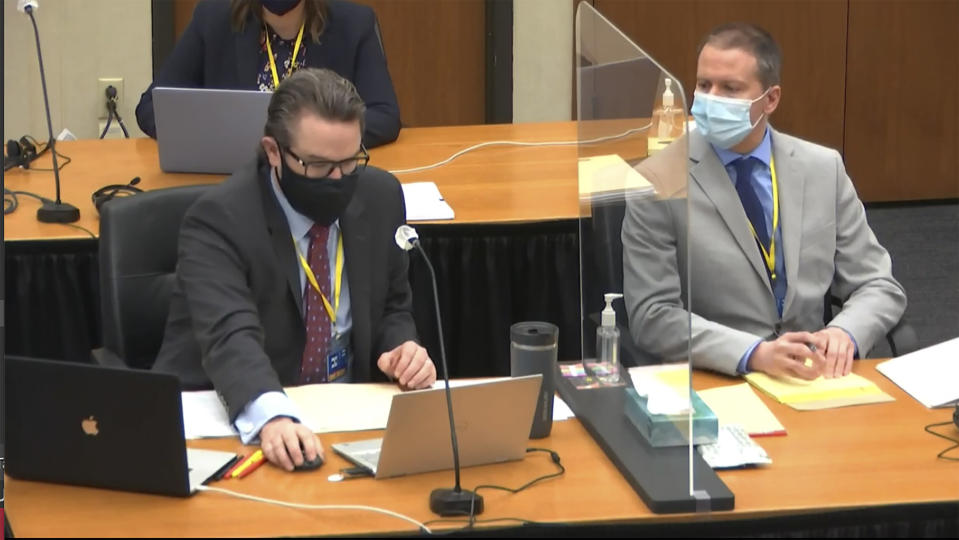 In this image from video, defense attorney Eric Nelson, left, and defendant, former Minneapolis police Officer Derek Chauvin, right, listen as Hennepin County Judge Peter Cahill presides in the trial of Chauvin, Tuesday, April 6, 2021, at the Hennepin County Courthouse in Minneapolis. Chauvin is charged in the May 25, 2020, death of George Floyd. (Court TV via AP, Pool)