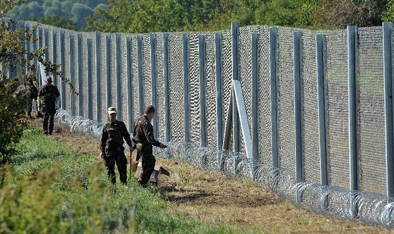 Hungary says it has stopped the influx of migrants and refugees after erecting a fence on its border with Croatia