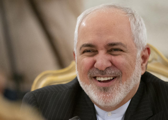 Iranian Foreign Minister Mohammad Javad Zarif smiles as he speaks to Russian Foreign Minister Sergey Lavrov during their talks in Moscow, Russia, Monday, Dec. 30, 2019. (AP Photo/Alexander Zemlianichenko)