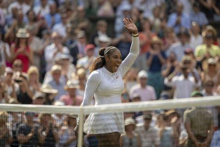 Jul 12, 2018; London, United Kingdom; Serena Williams (USA) celebrates match point during her match against Julia Goerges (GER) on day 10 at All England Lawn and Croquet Club. Mandatory Credit: Susan Mullane-USA TODAY Sports