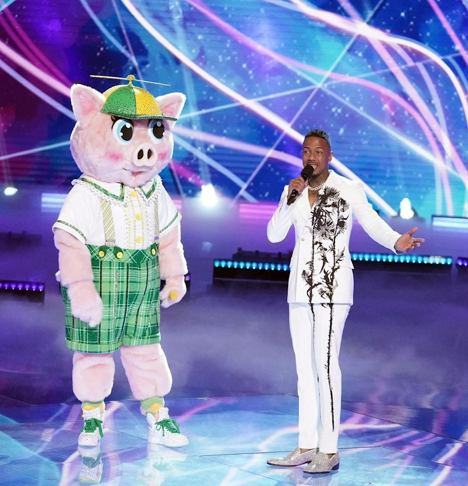"""""""Masked Singer"""" contestant Piglet with the show's host, Nick Cannon."""