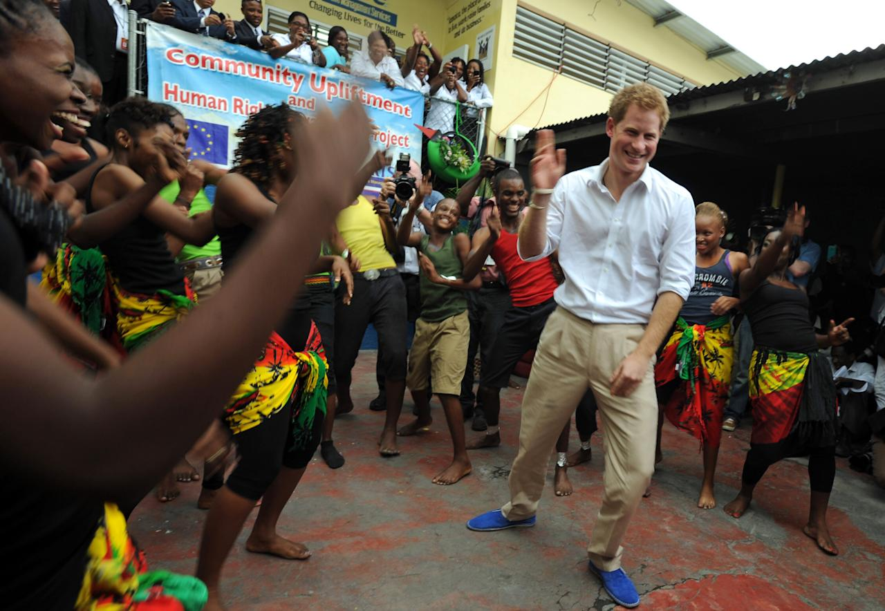 Britain's Prince Harry dances during a visit to the non-governmental organization RISE ( Reaching Individuals through Skills and Education ) in Kingston, Jamaica, Tuesday March 6, 2012. Harry is touring the Caribbean as part of a Diamond Jubilee tour in honor of Queen Elizabeth II as she celebrates 60 years on the throne. (AP Photo/Collin Reid)