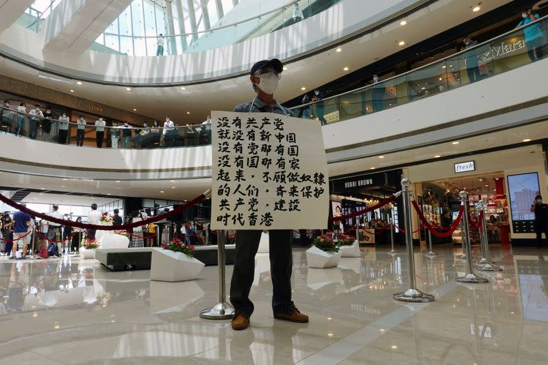FILE PHOTO: Pro-democracy demonstrator takes part in a lunchtime protest against the national security law, at a shopping mall in Hong Kong