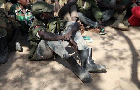 Rebel child soldiers gather in Gumuruk, as they prepare to handover their weapons at a demobilisation ceremony in Jonglei State, eastern South Sudan