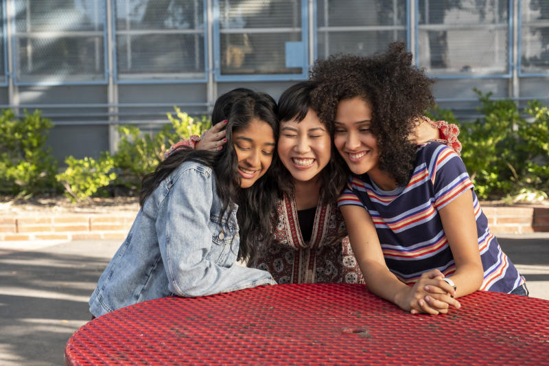 """This handout photo provided by Netflix shows Maitreyi Ramakrishnan as Devi Vishwakumar, from left, Ramona Young as Eleanor Wong and Lee Rodriguez as Fabiola Torres in a scene from """"Never Have I Ever."""" (Lara Solanki/Netflix via AP)"""