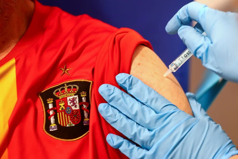 FILE PHOTO: Man receives his first dose of the AstraZeneca COVID-19 vaccine in Madrid