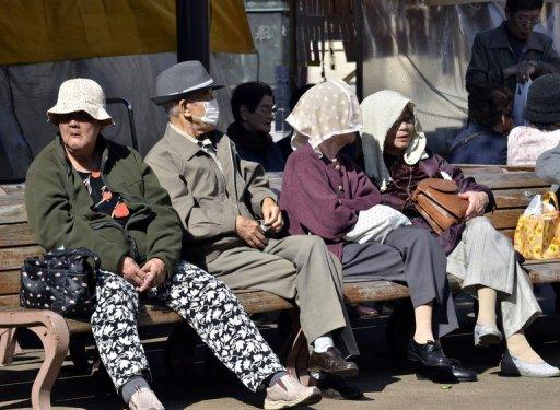 File picture shows a group of elderly people resting on a bench in Tokyo. Japanese researchers on Friday unveiled a population clock that showed the nation's people could theoretically become extinct in 1,000 years because of declining birth rates