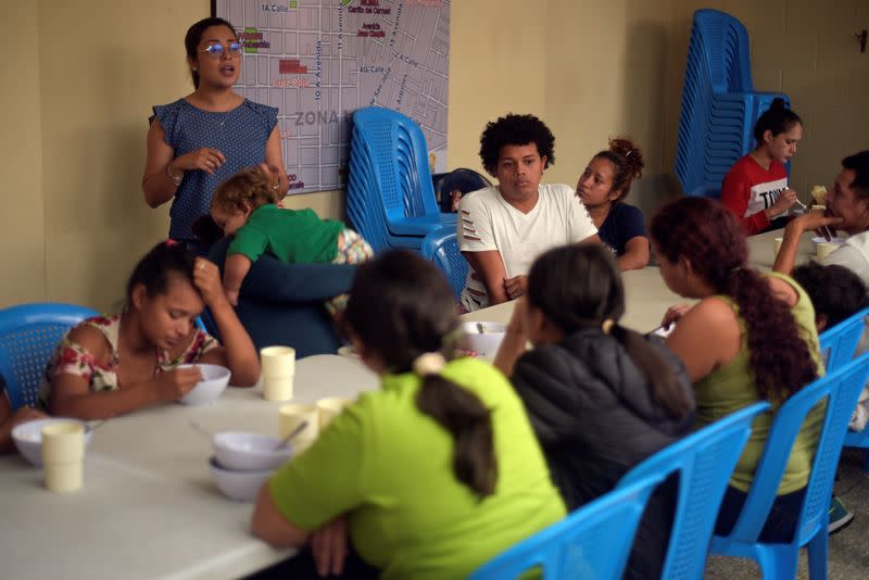 FILE PHOTO: Honduran migrants, sent back to Guatemala from the U.S., sit at the table after arriving at Casa del Migrante shelter in Guatemala City