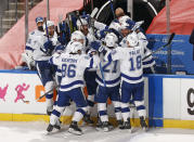 Teammates mob Tampa Bay Lightning defenseman Brayden Point (21) after he scored the game winning goal against the Florida Panthers during the third period in Game 1 of an NHL hockey Stanley Cup first-round playoff series, Sunday, May 16, 2021, in Sunrise, Fla. (AP Photo/Joel Auerbach)