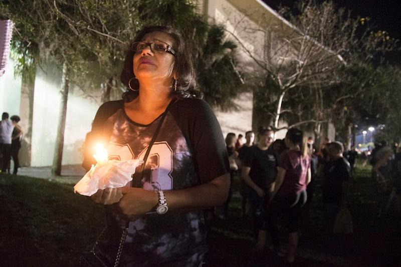 Donna Ali, mother of Marjory Stoneman Douglas High School student Arianna Ali, holds a candle at a vigil mourning those who died.