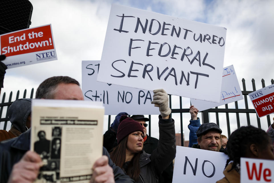 Union members and Internal Revenue Service workers rally outside an IRS Service Center to call for an end to the partial government shutdown, Thursday, Jan. 10, 2019, in Covington, Ky. (Photo credit: AP Photo/John Minchillo)