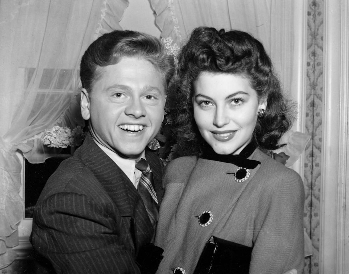 FILE - In this Jan. 5, 1942, file photo, Mickey Rooney, 21, Movieland's No. 1 box office star, and Ava Gardner, 19, of Wilson, N.C., pose together in Santa Barbara, Calif., shortly after the couple applied for a marriage license. Rooney, a Hollywood legend whose career spanned more than 80 years, has died. He was 93. Los Angeles Police Commander Andrew Smith said that Rooney was with his family when he died Sunday, April 6, 2014, at his North Hollywood home. (AP Photo/File)