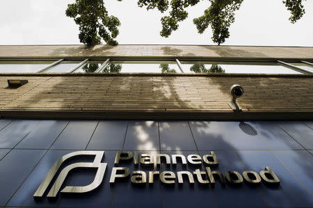 A sign is pictured at the entrance to a Planned Parenthood building in New York August 31, 2015. REUTERS/Lucas Jackson