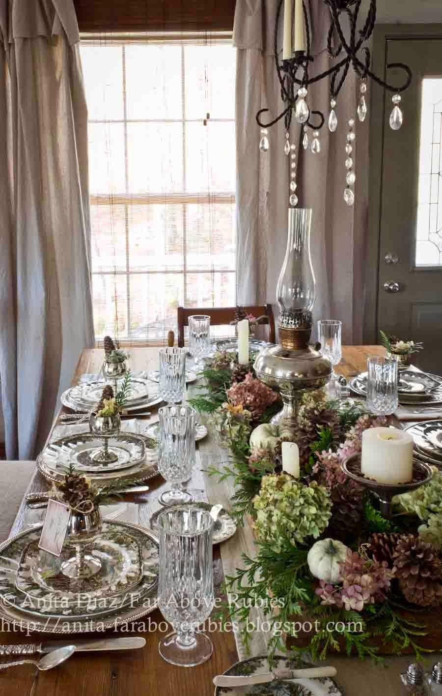 """<p>Far Above Rubies blogger Anita Diaz used an old chestnut board as her table's centerpiece, then filled it with arborvitae, hydrangeas, pinecones, and hand-painted pumpkins. To add an extra gleam, she placed silver sugar bowls and her great-grandfather's vintage oil lamp in the middle.</p><p><strong>Get the tutorial at <a href=""""http://anita-faraboverubies.blogspot.com/2013/11/friendly-village-thanksgiving.html"""" rel=""""nofollow noopener"""" target=""""_blank"""" data-ylk=""""slk:Far Above Rubies"""" class=""""link rapid-noclick-resp"""">Far Above Rubies</a>.</strong></p><p><strong><a class=""""link rapid-noclick-resp"""" href=""""https://www.amazon.com/SuperMoss-24511-Black-Spruce-8-Ounce/dp/B00K80EWGA/?tag=syn-yahoo-20&ascsubtag=%5Bartid%7C10050.g.2130%5Bsrc%7Cyahoo-us"""" rel=""""nofollow noopener"""" target=""""_blank"""" data-ylk=""""slk:SHOP PINECONES""""><strong>SHOP PINECONES</strong></a><br></strong></p>"""
