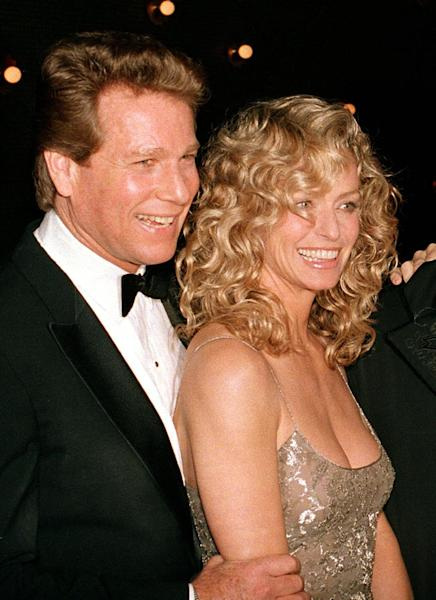 "FILE - This March 5, 1989 file photo shows actors Ryan O'Neal, left, and Farrah Fawcett at the premiere of the film. ""Chances Are,"" in New York. Jury selection could begin as early as Thursday, Nov. 21, 2013, in a Los Angeles courtroom in a dispute between O'Neal and the University of Texas at Austin over the ownership of an Andy Warhol portrait of Fawcett. (AP Photo/Ray Stubblebine, file)"
