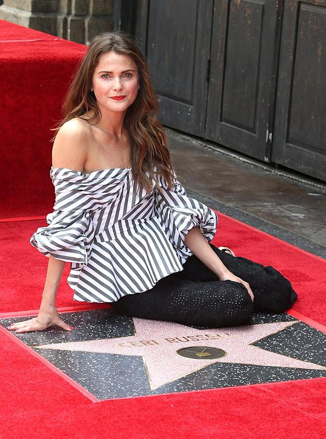 """<p>More than 25 years after she first appeared on <i>The Mickey Mouse Club</i>, Russell was <a href=""""https://www.yahoo.com/celebrity/keri-russell-apos-felicity-apos-203400810.html"""" data-ylk=""""slk:honored with a star"""" class=""""link rapid-noclick-resp"""">honored with a star</a> on the Hollywood Walk of Fame. Her real-life partner and co-star on <i>The Americans</i>, Matthew Rhys, and her love interest on <i>Felicity</i>, Scott Speedman, were both there to cheer her on. (Photo: BACKGRID) </p>"""