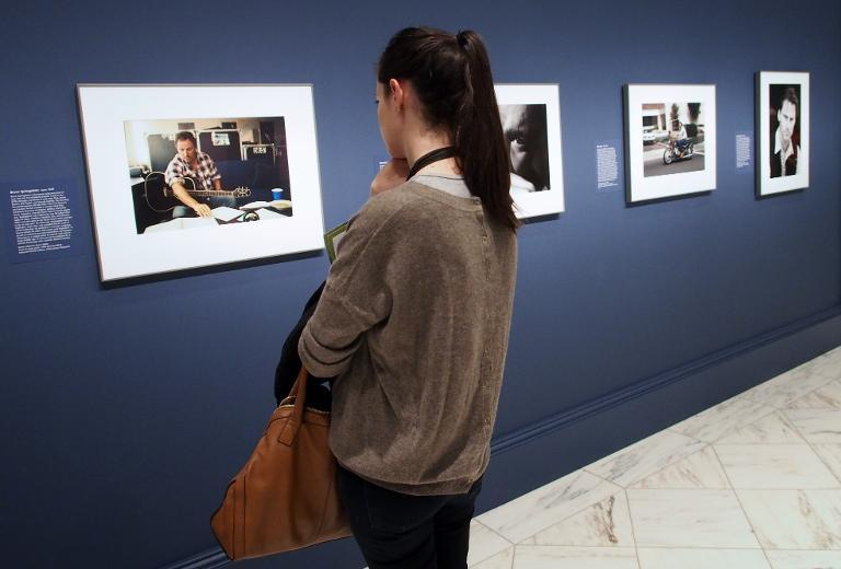 """A visitor reflects on a photograph of rock icon Bruce Springsteen by Annie Leibovitz at a February 5, 2014 press preview of the """"American Cool"""" exhibition at the National Portrait Gallery in Washington, DC"""