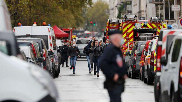 PHOTO: Police run in the area where two people were attacked with a knife near the former offices of the satirical newspaper Charlie Hebdo in Paris, Sept. 25, 2020. (Thibault Camus/AP)