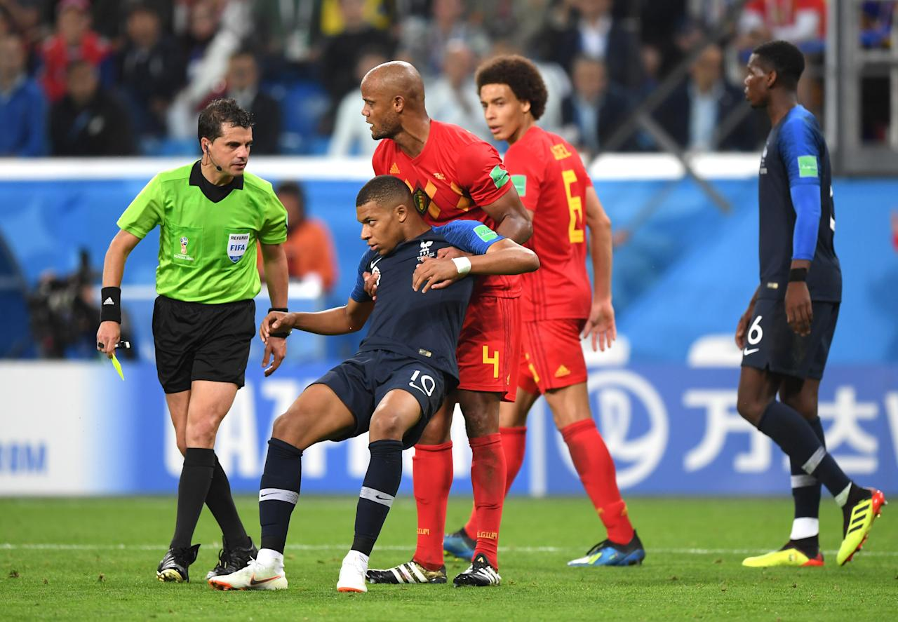 <p>Kylian Mbappe of France is shown a yellow card by referee Andres Cunha during the 2018 FIFA World Cup Russia Semi Final match between Belgium and France at Saint Petersburg Stadium on July 10, 2018 in Saint Petersburg, Russia. (Photo by Shaun Botterill/Getty Images) </p>