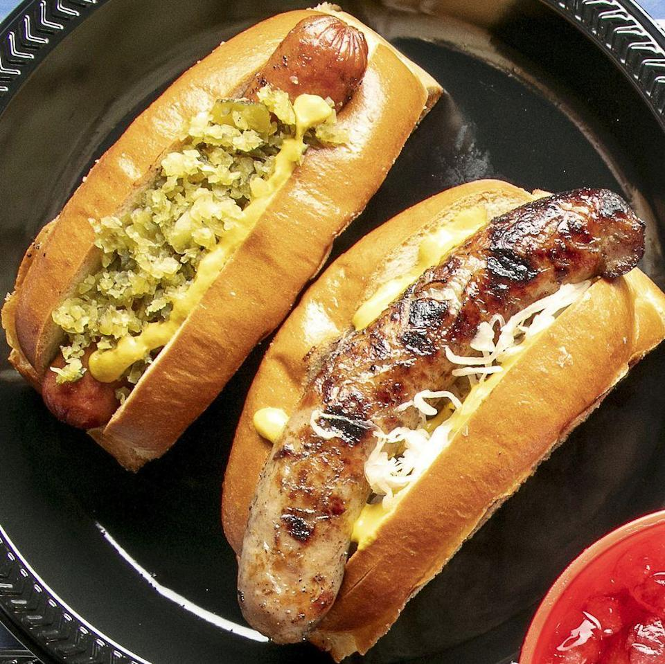 """<p>Set up a hot dog bar for your backyard bash. There are plenty of fun and flavorful toppings, like spicy jalapeño relish, sauerkraut, and mustard. </p><p><strong><a href=""""https://www.thepioneerwoman.com/food-cooking/recipes/a35980476/hot-dogs-and-bratwurst-with-sauerkraut-and-relish-recipe/"""" rel=""""nofollow noopener"""" target=""""_blank"""" data-ylk=""""slk:Get Ree's recipe."""" class=""""link rapid-noclick-resp"""">Get Ree's recipe.</a></strong></p><p><a class=""""link rapid-noclick-resp"""" href=""""https://go.redirectingat.com?id=74968X1596630&url=https%3A%2F%2Fwww.walmart.com%2Fsearch%2F%3Fquery%3Dpioneer%2Bwoman%2Bsaucepan&sref=https%3A%2F%2Fwww.thepioneerwoman.com%2Ffood-cooking%2Fmeals-menus%2Fg36109352%2Ffathers-day-dinner-recipes%2F"""" rel=""""nofollow noopener"""" target=""""_blank"""" data-ylk=""""slk:SHOP SAUCEPANS"""">SHOP SAUCEPANS</a></p>"""