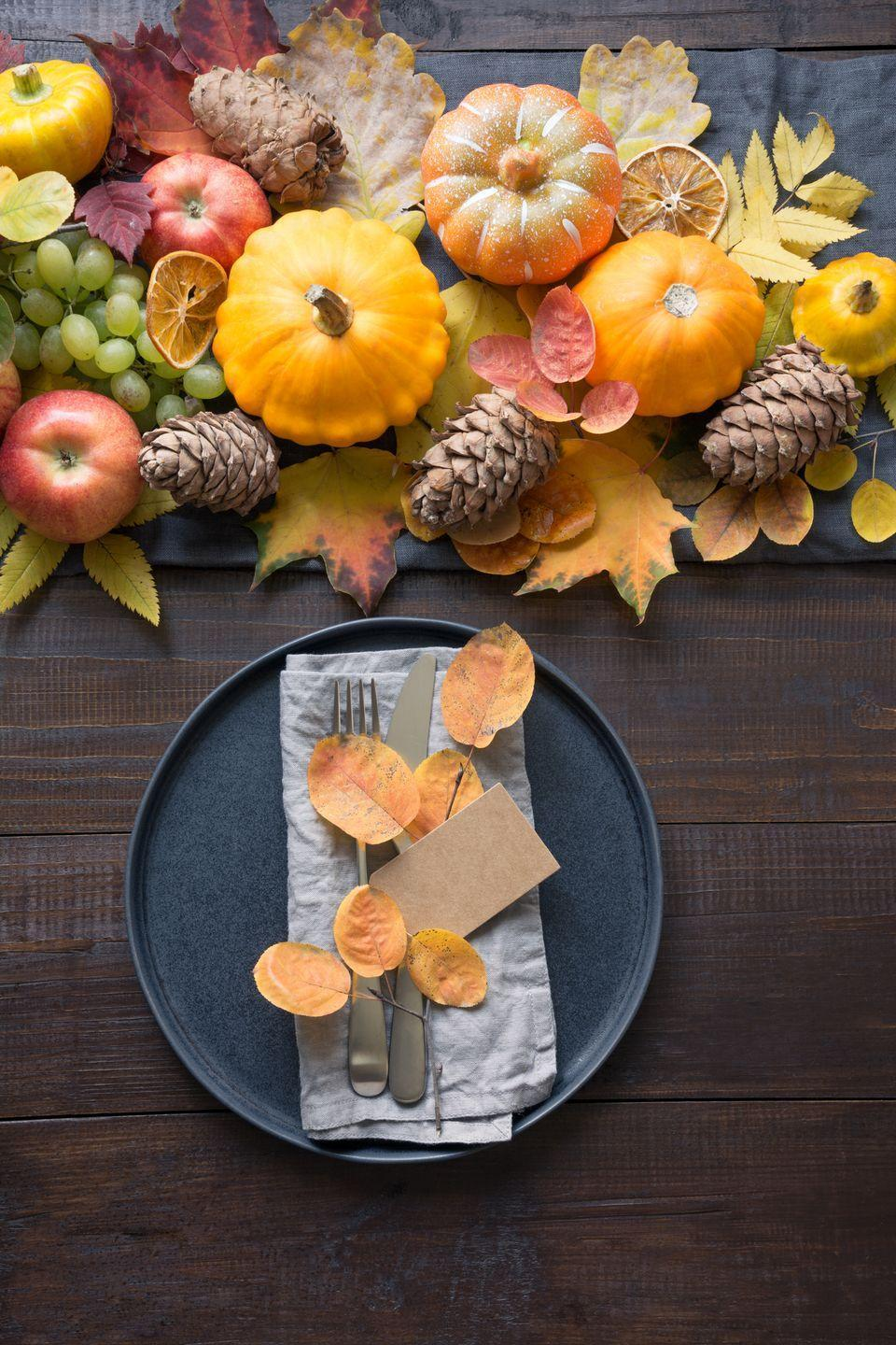 """<p>This centerpiece lets fall's bounty take centerstage, with a mix of fresh and dried fruit, pinecones, and autumn leaves. Extend the theme onto place setting by placing smaller leaves in the center of dinner plates. </p><p><a class=""""link rapid-noclick-resp"""" href=""""https://www.amazon.com/Dehydrated-Blood-Orange-Wheels-slices/dp/B084GB2MMM/ref=sr_1_4?dchild=1&keywords=dried+fruit+slice&qid=1629996278&sr=8-4&tag=syn-yahoo-20&ascsubtag=%5Bartid%7C10050.g.2130%5Bsrc%7Cyahoo-us"""" rel=""""nofollow noopener"""" target=""""_blank"""" data-ylk=""""slk:SHOP DRIED FRUIT SLICES"""">SHOP DRIED FRUIT SLICES</a></p>"""