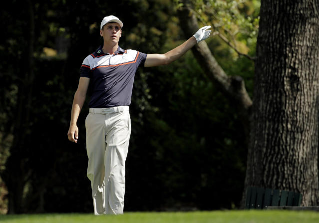Oliver Goss, of Australia, points to his ball after teeing off on the second hole during the fourth round of the Masters golf tournament Sunday, April 13, 2014, in Augusta, Ga. (AP Photo/Charlie Riedel)