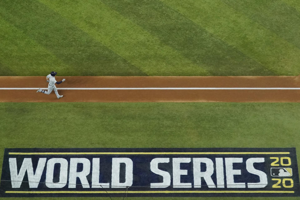 Tampa Bay Rays' Brandon Lowe rounds the bases after hitting a home run against the Los Angeles Dodgers during the first inning in Game 2 of the baseball World Series Wednesday, Oct. 21, 2020, in Arlington, Texas. (AP Photo/David J. Phillip)