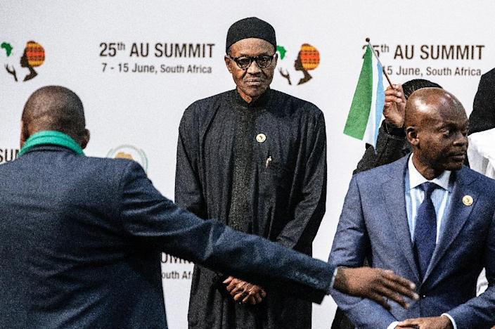Muhammadu Buhari arrives for a photo call at the African Union Summit in Sandton, South Africa, on June 14, 2015 (AFP Photo/Gianluigi Guercia)