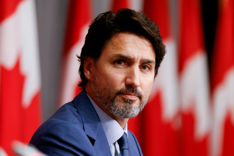 FILE PHOTO: FILE PHOTO: Canada's Prime Minister Justin Trudeau takes part in a news conference on Parliament Hill in Ottawa