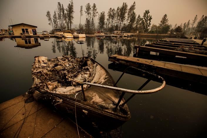 Wildfire destroyed and sunk boats docked at the marina in Whiskeytown, California.