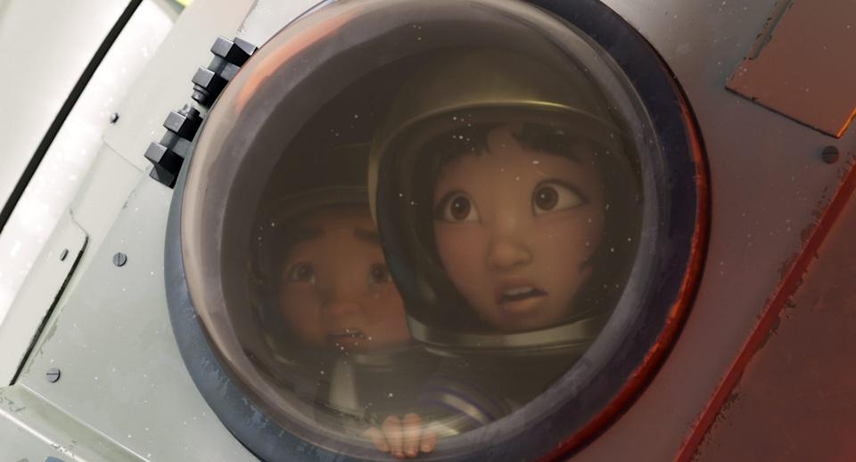 """A young girl (voiced by Cathy Ang) builds a rocket ship and travels to space with her future stepbrother (Robert G. Chiu) to prove the existence of a fabled Moon Goddess in """"Over the Moon."""""""