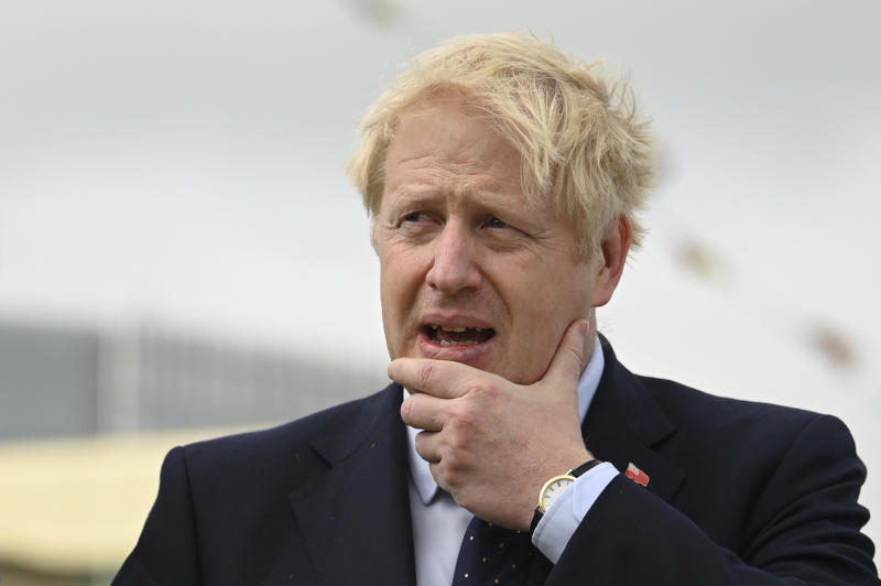Britain's Prime Minister Boris Johnson visits the NLV Pharos, a lighthouse tender moored on the river Thames, to mark London International Shipping Week in London, Thursday, Sept. 12, 2019. The British government insisted Thursday that its forecast of food and medicine shortages, gridlock at ports and riots in the streets after a no-deal Brexit is an avoidable worst-case scenario, as Prime Minister Boris Johnson denied misleading Queen Elizabeth II about his reasons for suspending Parliament just weeks before the country is due to leave the European Union. (Daniel Leal-Olivas/Pool photo via AP)