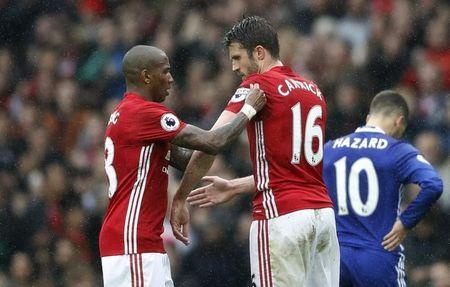 Britain Soccer Football - Manchester United v Chelsea - Premier League - Old Trafford - 16/4/17 Manchester United's Ashley Young gives the captains armband to Michael Carrick  Action Images via Reuters / Carl Recine Livepic