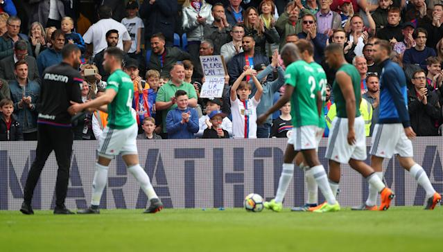 "Soccer Football - Premier League - Crystal Palace vs West Bromwich Albion - Selhurst Park, London, Britain - May 13, 2018 Crystal Palace fans applaud the players after the match REUTERS/Hannah McKay EDITORIAL USE ONLY. No use with unauthorized audio, video, data, fixture lists, club/league logos or ""live"" services. Online in-match use limited to 75 images, no video emulation. No use in betting, games or single club/league/player publications. Please contact your account representative for further details."