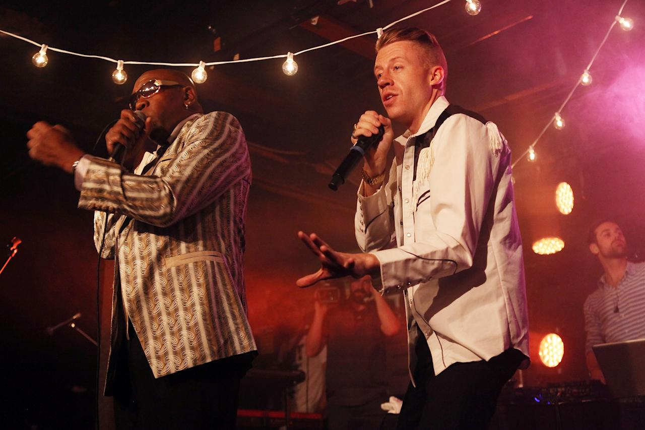 AUSTIN, TX - MARCH 12:  Wanz (L) and Macklemore perform onstage at the iHeartRadio Official SXSW Showcase on March 12, 2013 in Austin, Texas.  (Photo by Roger Kisby/Getty Images for iHeartradio)