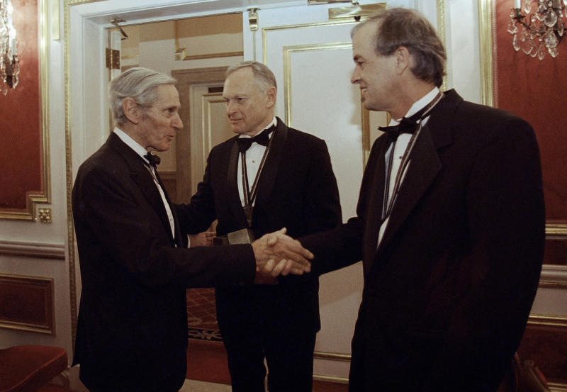 """FILE - In this Nov. 16, 1994, file photo, The National Book Awards prize winning writers, William Gaddis, left, Sherwin B. Nuland, center, and James Tate greet each other after the awards ceremony in New York. Nuland, the author of 1994 National Book Award winner """"How We Die,"""" has died at age 83. Nuland died of prostate cancer on Monday, March 3, 2014, at his home in Hamden, said his daughter Amelia Nuland, who recalled how he told her he wasn't ready for death because he loved life. (AP Photo/Adam Nadel, File)"""