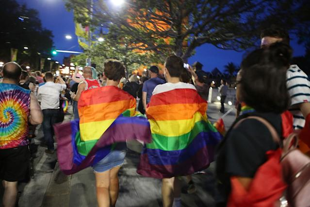<p>Crowds supporting the Same Sex Marriage Survey party down Oxford St., in the heart of Sydney's gay precinct on Nov. 15, 2017 in Sydney, Australia. (Photo: James Alcock/Getty Images) </p>