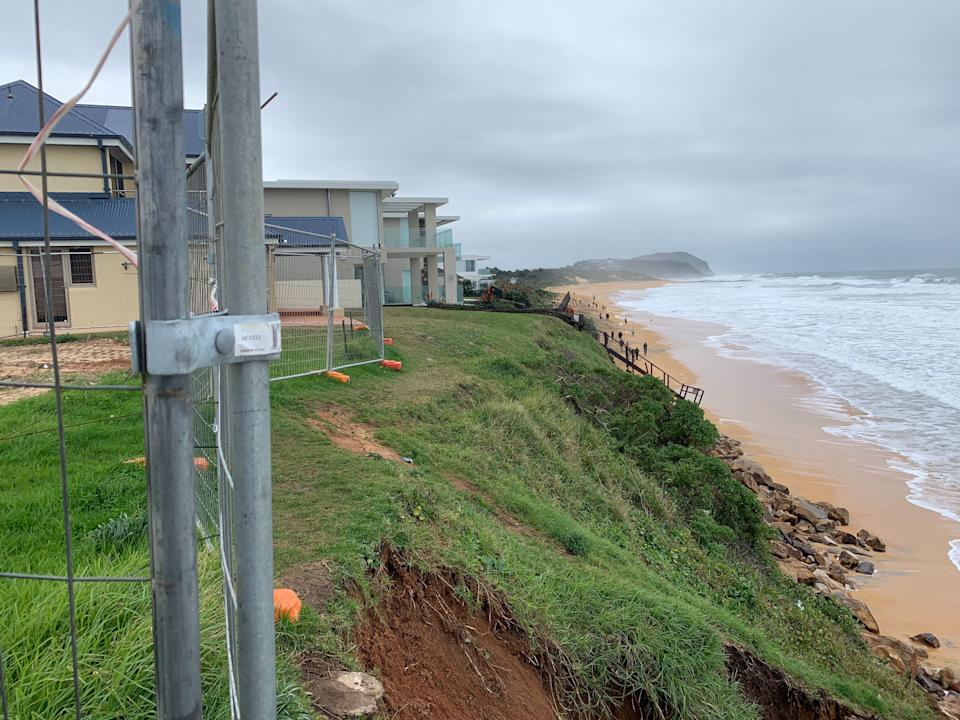 Pictured is a side view of homes showing how close they are to the edge of the dune.
