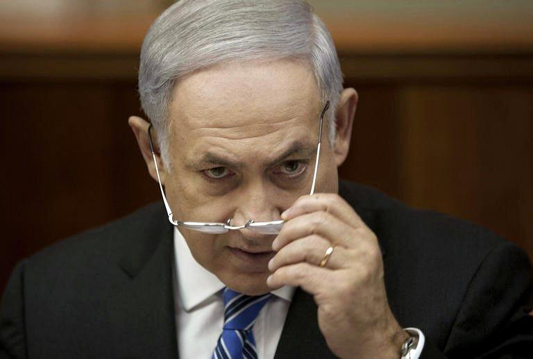 Israeli Prime Minister Benjamin Netanyahu attends the weekly cabinet meeting in his Jerusalem office. Prime Minister Benjamin Netanyahu on Sunday promised change as he tried to ease growing anger over the cost of living after an unprecedented number of Israelis took part in nationwide protests