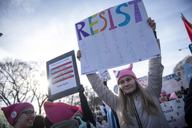 <p>Demonstrators hold signs during the second annual Women's March in Chicago, IIl., on Saturday, Jan. 20, 2018. (Photo: Christopher Dilts/Bloomberg via Getty Images) </p>