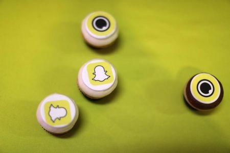 The logo of messaging app Snapchat is seen at a booth at TechFair LA, a technology job fair, in Los Angeles