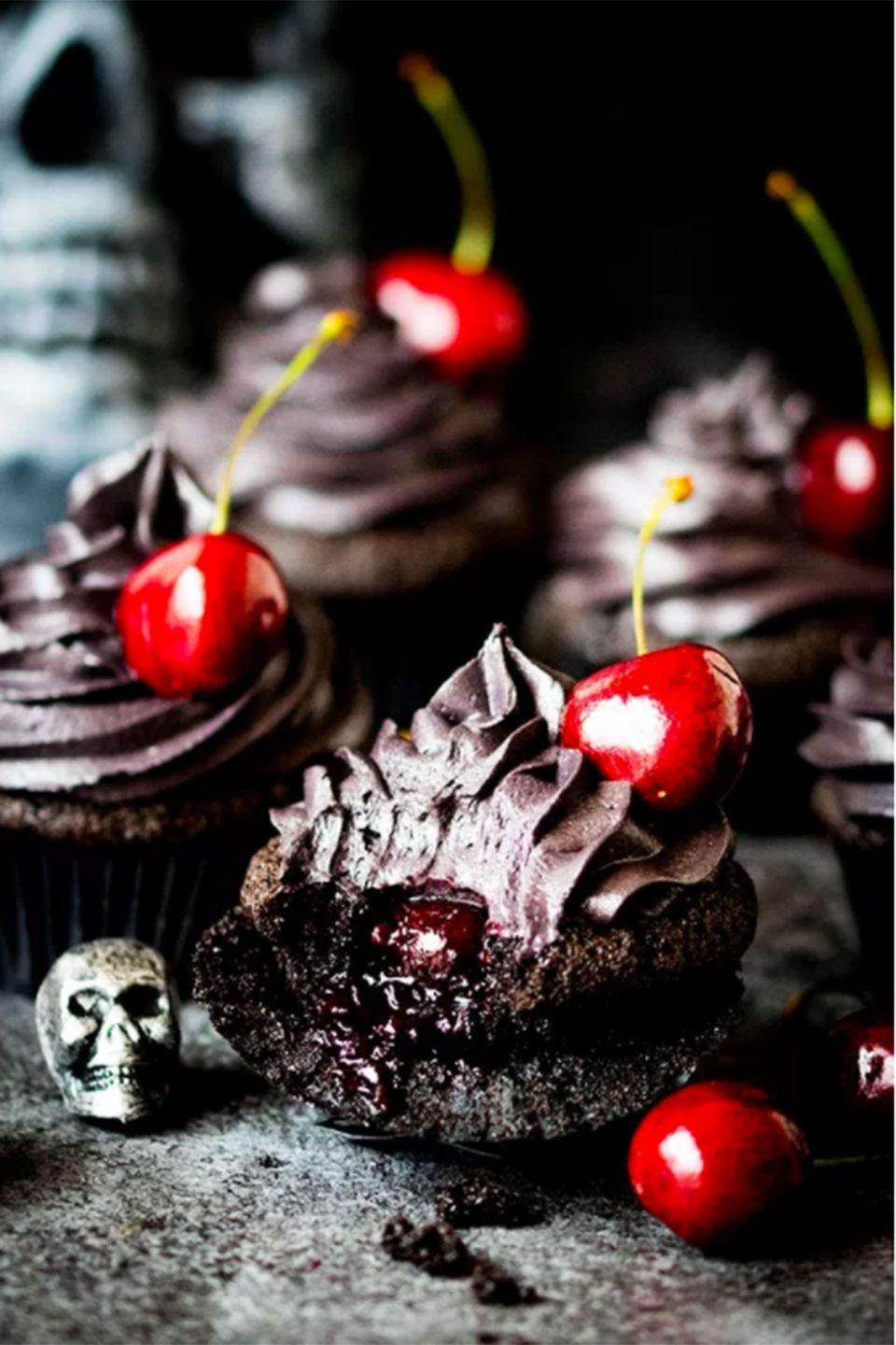 """<p>Why have death by chocolate when you can have death by cherry-filled chocolate?</p><p><strong>Get the recipe at <a href=""""http://www.kitchensanctuary.com/2016/09/halloween-black-cupcakes-cherry-filling/"""" rel=""""nofollow noopener"""" target=""""_blank"""" data-ylk=""""slk:Kitchen Sanctuary"""" class=""""link rapid-noclick-resp"""">Kitchen Sanctuary</a>. </strong></p>"""