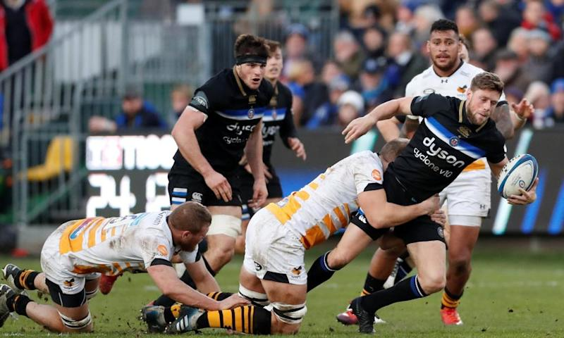 Rhys Priestland is tackled by Joe Launchbury during Bath's win.